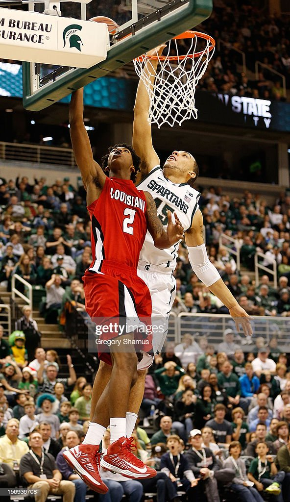 Elfrid Payton #2 of the Louisiana-Lafayette Ragin' Cajuns gets to the basket for a second half layup in front of Denzel Valentine #45 of the Michigan State Spartans at the Jack T. Breslin Student Events Center on November 25, 2012 in East Lansing, Michigan. Michigan State won the game 63-60.