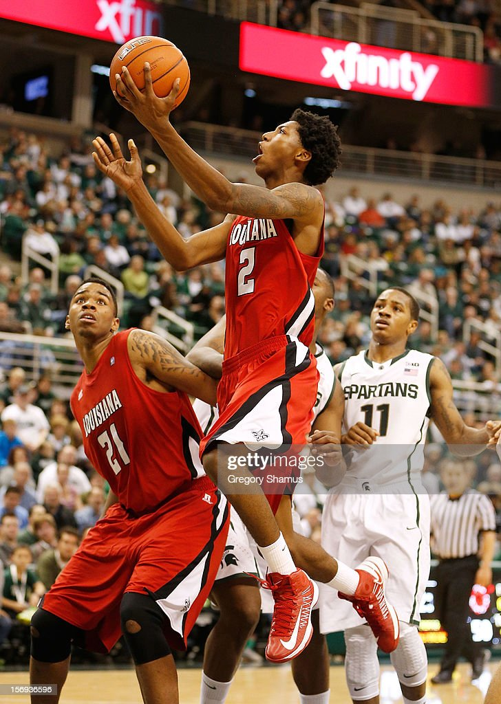Elfrid Payton #2 of the Louisiana-Lafayette Ragin' Cajuns gets to the basket in the second half in front of Keith Appling #11 of the Michigan State Spartans at the Jack T. Breslin Student Events Center on November 25, 2012 in East Lansing, Michigan. Michigan State won the game 63-60.