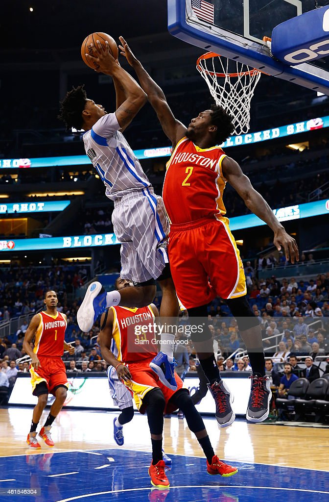 Elfrid Payton #4 of the Orlando Magic attempts a shot over Patrick Beverley #2 of the Houston Rockets during the game at Amway Center on January 14, 2015 in Orlando, Florida.