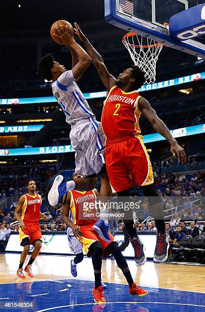 Elfrid Payton of the Orlando Magic attempts a shot over Patrick Beverley of the Houston Rockets during the game at Amway Center on January 14 2015 in...