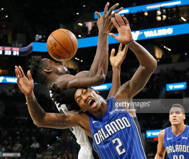 Elfrid Payton of the Orlando Magic battles Amida Brimah of the San Antonio Spurs for a loose ball at ATT Center on October 10 2017 in San Antonio...