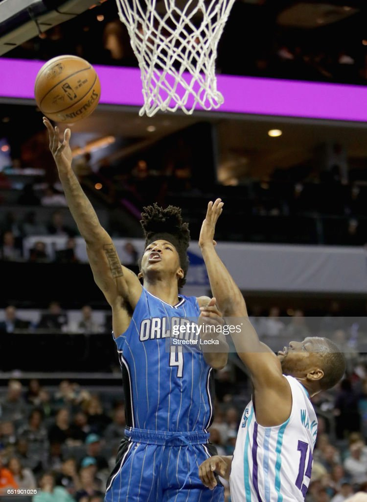 Elfrid Payton #4 of the Orlando Magic drives to the basket against Kemba Walker #15 of the Charlotte Hornets during their game at Spectrum Center on March 10, 2017 in Charlotte, North Carolina.