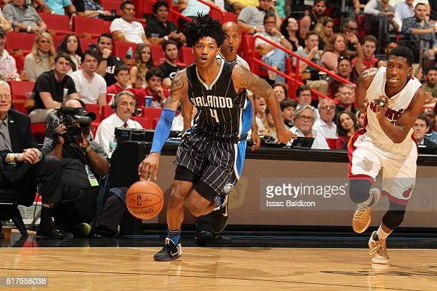 Elfrid Payton of the Orlando Magic drives to the basket against the Miami Heat on March 25 2016 at AmericanAirlines Arena in Miami Florida NOTE TO...