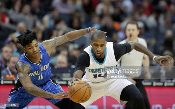 Elfrid Payton of the Orlando Magic goes after a loose ball agianst Michael KiddGilchrist of the Charlotte Hornets during their game at Spectrum...