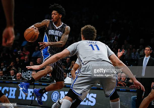 Elfrid Payton of the Orlando Magic in action against Brook Lopez of the Brooklyn Nets during an NBA basketball game at the Barclays Center in the...