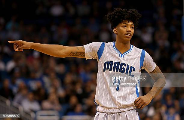 Elfrid Payton of the Orlando Magic points during the game against the Charlotte Hornets at Amway Center on January 22 2016 in Orlando Florida NOTE TO...