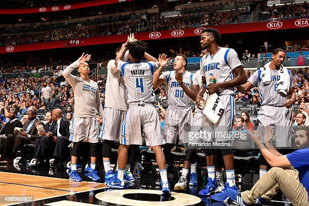 Elfrid Payton of the Orlando Magic shakes hands with his teammates during the game against the Milwaukee Bucks on November 27 2015 at Amway Center in...