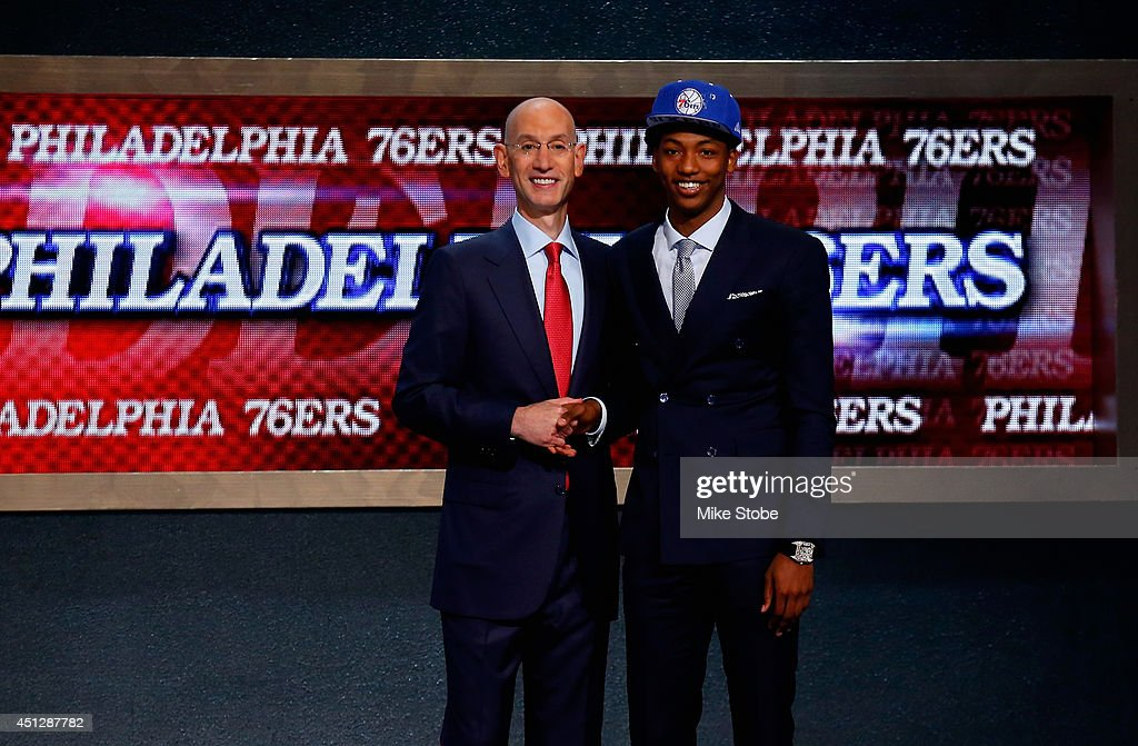 Elfried Payton (R) of Louisiana-Lafayette shakes hands with NBA Commissioner Adam Silver after being drafted with the #10 overall pick by the Philadelphia 76ers during the 2014 NBA Draft at Barclays Center on June 26, 2014 in the Brooklyn borough of New York City.