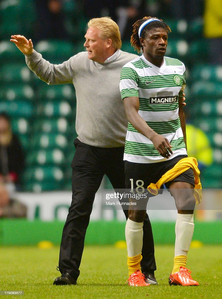 Elfsborg manager Jorgen Lennartsson with striker Mohamed Bangura of Elfsborg wearing a Celtic shirt of his parent club at the end of the UEFA Champions League Third Qualifying Round First Leg match between Celtic and Elfsborg at Celtic Park Stadium on July 31, 2013 in Glasgow, Scotland.