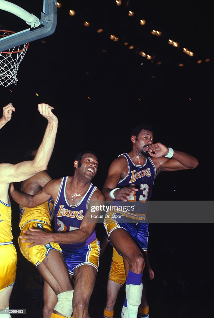 Elgin Baylor and Wilt Chamberlain of the Los Angeles Lakers in action against the San Francisco Warriors during an NBA basketball game circa 1968 at...