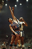 Elgin Baylor of the Los Angeles Lakers battles for rebound against Cliff Hagan of the St Louis Hawks in Los Angeles California NOTE TO USER User...