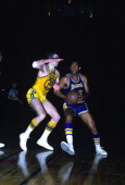 Elgin Baylor of the Los Angeles Lakers drives on Rudy LaRusso of the San Francisco Warriors during an NBA basketball game circa 1968 at the Cow...