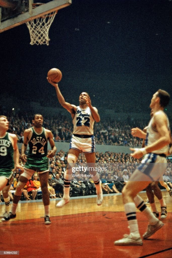 Elgin Baylor of the Los Angeles Lakers goes for a layup against the Boston Celtics during the NBA game at the Los Angeles Sports Arena circa 1960's...