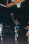 Elgin Baylor of the Los Angeles Lakers goes in for a layup against the Boston Celtics during an NBA basketball game circa 1965 at the Boston Garden...