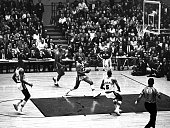 Elgin Baylor of the Los Angeles Lakers goes up for the layup as his teammate Dick Barnett looks on during the 1963 NBA Finals against the Boston...