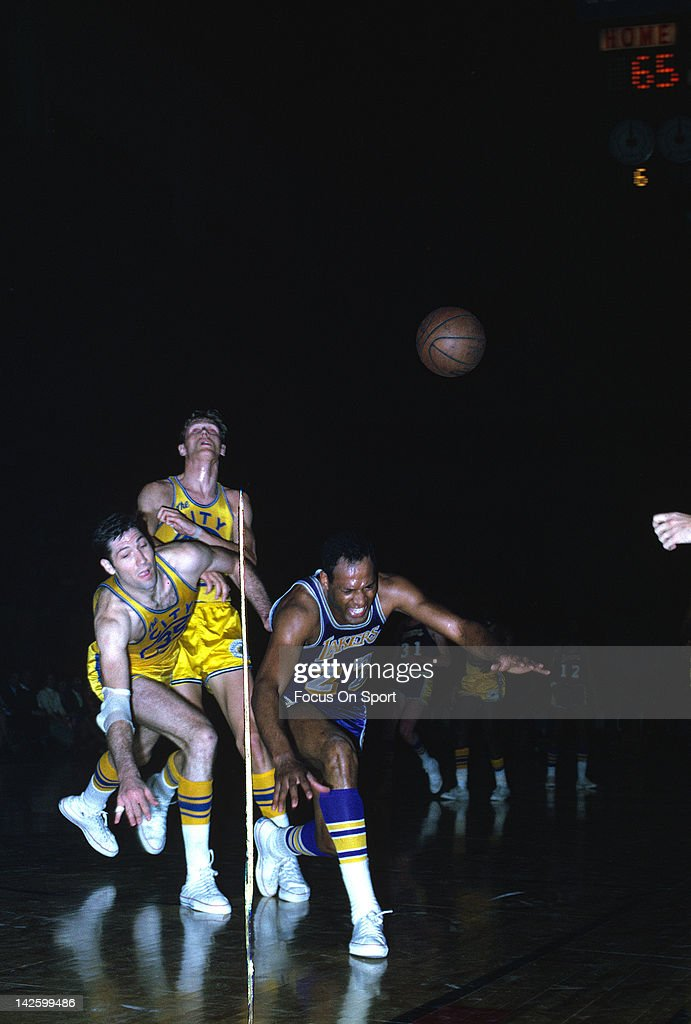 Elgin Baylor of the Los Angeles Lakers in action against the San Francisco Warriors during an NBA basketball game circa 1968 at the Cow Palace in San...
