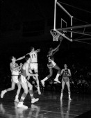 Elgin Baylor of the Los Angeles Lakers shoots against the Syracuse Nationals circa 1963 at the Onondaga War Memorial Arena in Syracuse New York NOTE...