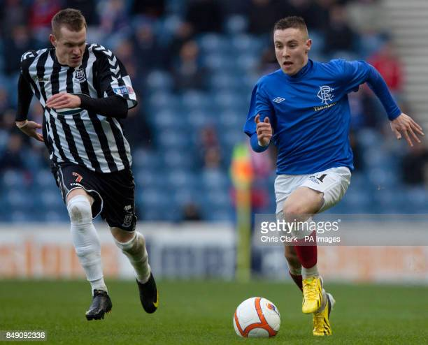 Elgin City's Craig Gunn battles for the ball with Rangers' Barrie McKay during the Scottish Cup Fourth Round match at Ibrox Glasgow