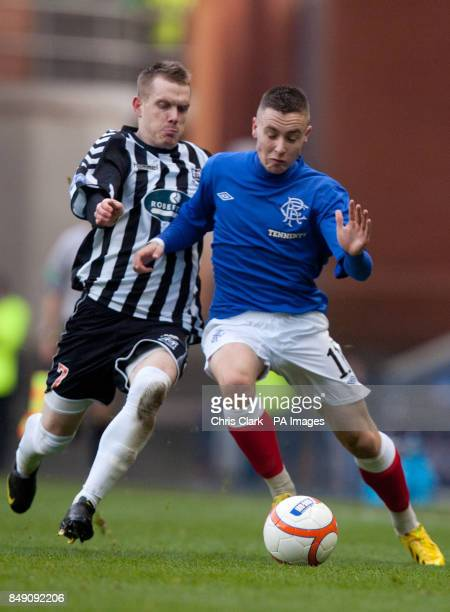 Elgin City's Craig Gunn battles with Rangers' Barrie McKay during the Scottish Cup Fourth Round match at Ibrox Glasgow