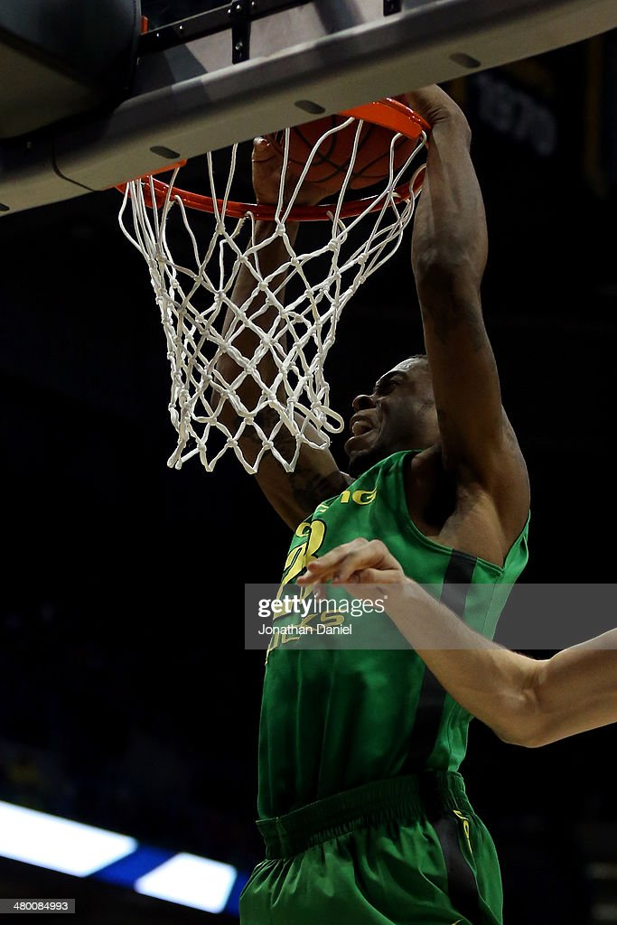 Elgin Cook of the Oregon Ducks dunks the ball during the third round of the 2014 NCAA Men's Basketball Tournament at BMO Harris Bradley Center on...