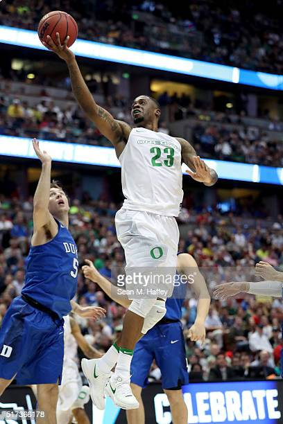 Elgin Cook of the Oregon Ducks goes up for a shot against Luke Kennard of the Duke Blue Devils in the 2016 NCAA Men's Basketball Tournament West...