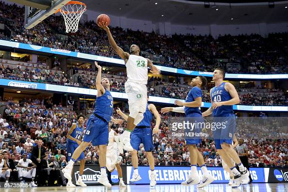 Elgin Cook of the Oregon Ducks goes up for a shot against Luke Kennard of the Duke Blue Devils in the second half in the 2016 NCAA Men's Basketball...