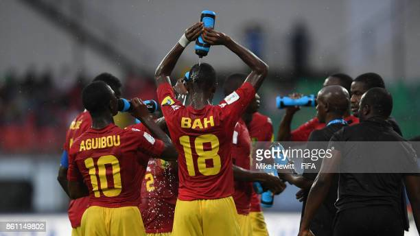 Elhadj Bah of Guinea cools down during a water break in the FIFA U17 World Cup India 2017 group C match between Guinea and Germany at Jawaharlal...
