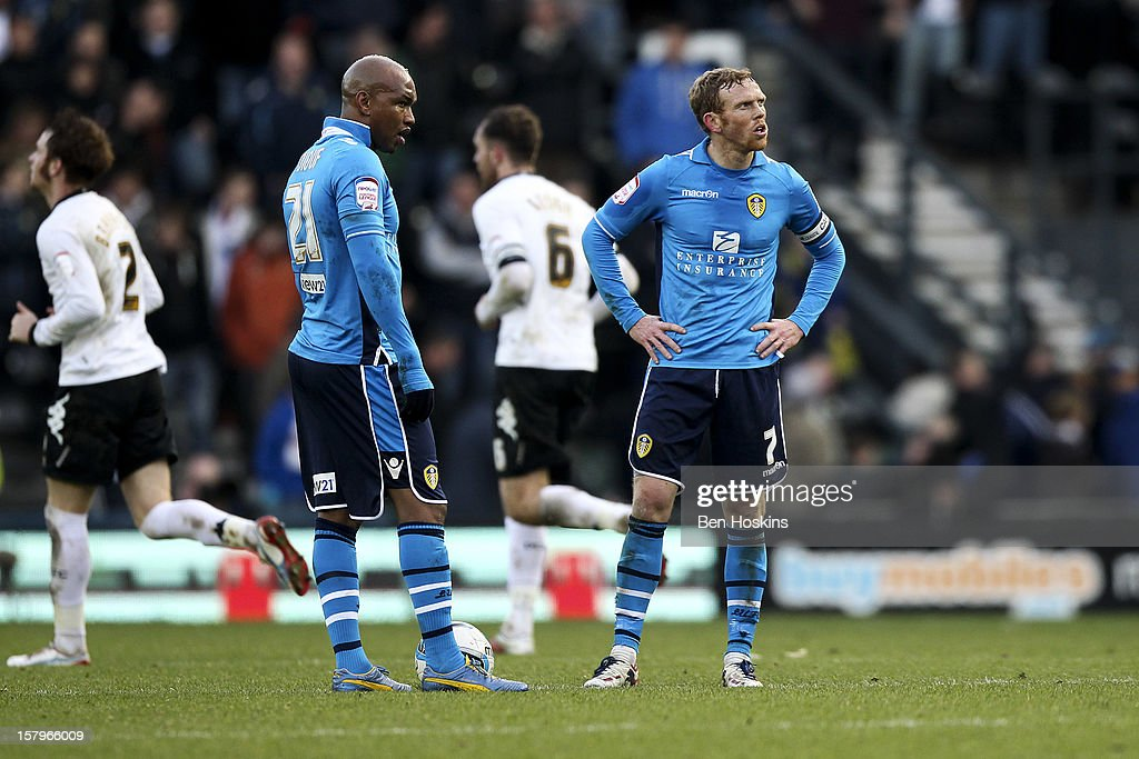 El-Hadji Diouf and Paul Green of Leeds look dejected after Ben Davies scored Derby's third goal of the game during the npower Championship match between Derby County and Leeds United at Pride Park on December 8, 2012 in Derby, England.