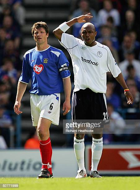 ElHadji Diouf of Bolton and Arjan de Zeeuw of Portsmouth look on during the FA Barclays Premiership match between Portsmouth and Bolton Wanderers...