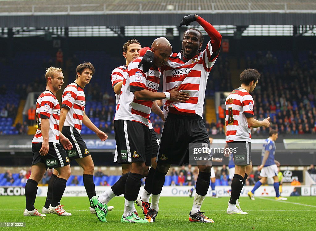 <a gi-track='captionPersonalityLinkClicked' href=/galleries/search?phrase=El-Hadji+Diouf&family=editorial&specificpeople=204332 ng-click='$event.stopPropagation()'>El-Hadji Diouf</a> of Doncaster celebrates his goal with <a gi-track='captionPersonalityLinkClicked' href=/galleries/search?phrase=Pascal+Chimbonda&family=editorial&specificpeople=490976 ng-click='$event.stopPropagation()'>Pascal Chimbonda</a> during the npower Championship match between Ipswich Town and Doncaster Rovers at Portman Road on November 5, 2011 in Ipswich, England.
