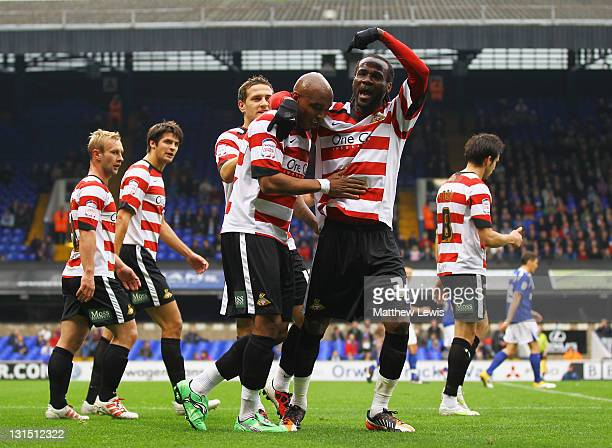 ElHadji Diouf of Doncaster celebrates his goal with Pascal Chimbonda during the npower Championship match between Ipswich Town and Doncaster Rovers...