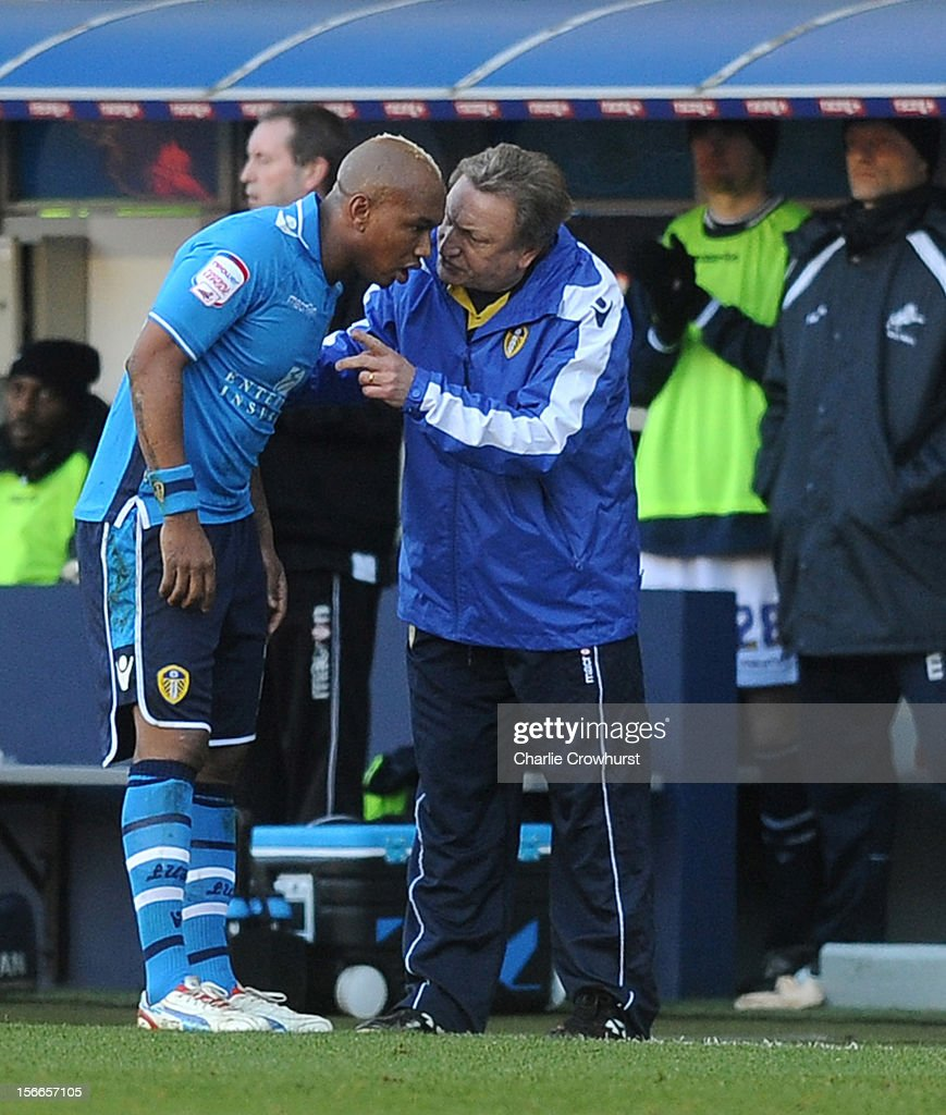 El-Hadji Diouf of Leeds has a word with manager <a gi-track='captionPersonalityLinkClicked' href=/galleries/search?phrase=Neil+Warnock&family=editorial&specificpeople=644786 ng-click='$event.stopPropagation()'>Neil Warnock</a> during the npower Championship match between Millwall and Leeds United at The New Den on November 18, 2012 in London, England.
