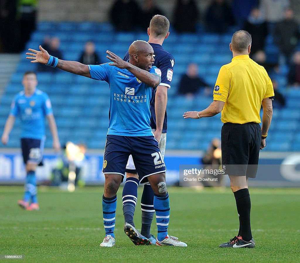 El-Hadji Diouf of Leeds has words with ref Mark Halsey during the npower Championship match between Millwall and Leeds United at The New Den on November 18, 2012 in London, England.