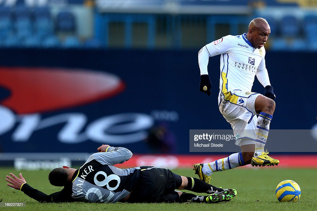 El-Hadji Diouf of Leeds is tackled by Kyle Walker of Spurs during the FA Cup with Budweiser Fourth Round match between Leeds United and Tottenham Hotspur at Elland Road on January 27, 2013 in Leeds, England.