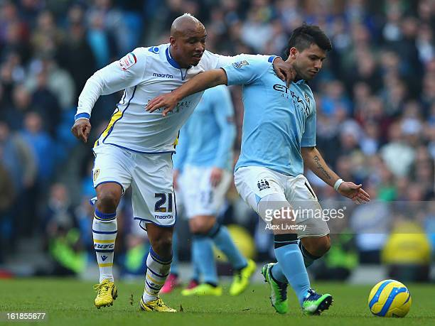 ElHadji Diouf of Leeds United tussles for posession with Sergio Aguero of Manchester City during the FA Cup with Budweiser Fifth Round match between...
