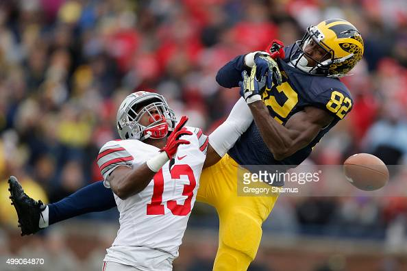 Eli Apple of the Ohio State Buckeyes breaks up a pass intended for Amara Darboh of the Michigan Wolverines in the first half at Michigan Stadium on...