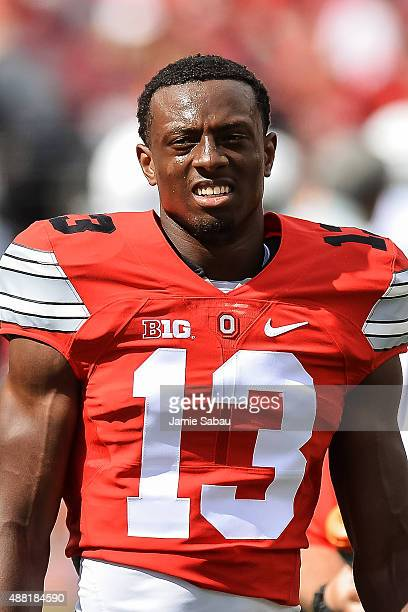 Eli Apple of the Ohio State Buckeyes warms up before a game against the Hawaii Rainbow Warriors at Ohio Stadium on September 12 2015 in Columbus Ohio