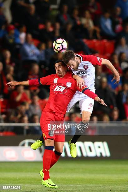 Eli Babalj of Adelaide and Robert Cornthwaite of the Wanderers contest a header during the round 27 ALeague match between Adelaide United and the...