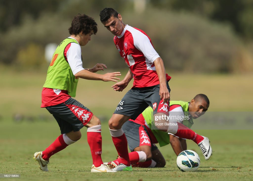 Eli Babalj (C) of the Heart competes for the ball during a Melbourne Heart A-League training session at La Trobe University Sports Fields on February 21, 2013 in Melbourne, Australia.