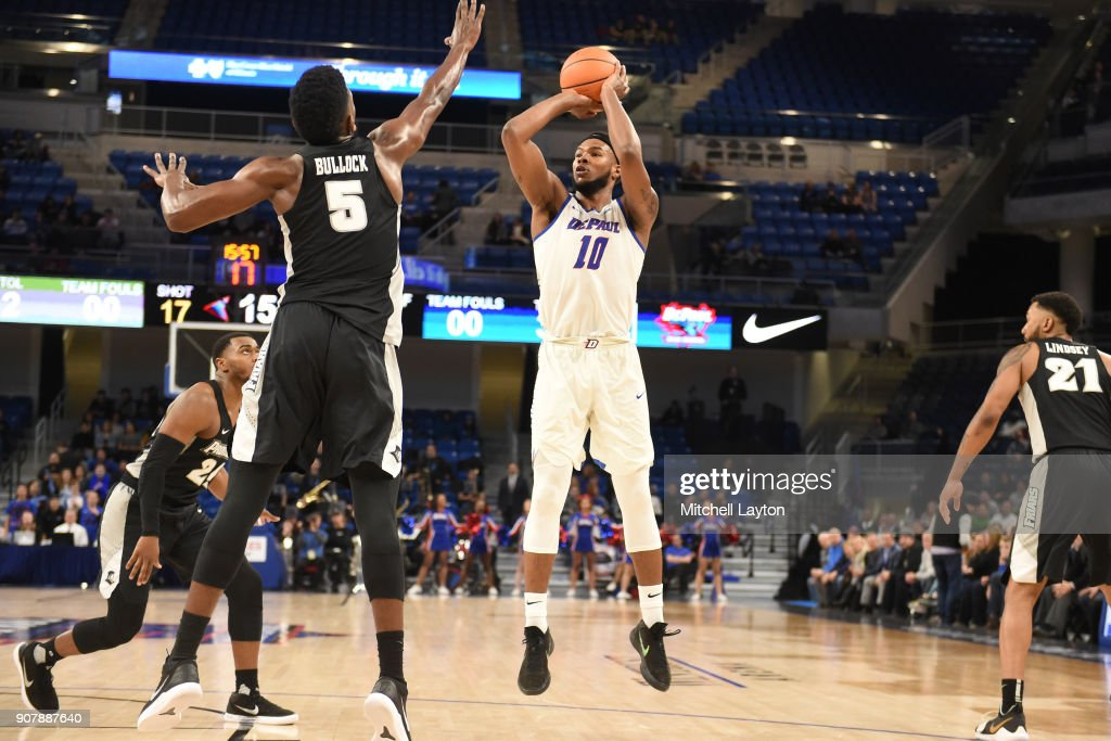 Eli Cain #11 of the DePaul Blue Demons takes a shot Rodney Bullock #5 of the Providence Friars during a college basketball game at Wintrust Arena on January 12, 2018 in Chicago, Illinois. The Friars won 71-64.