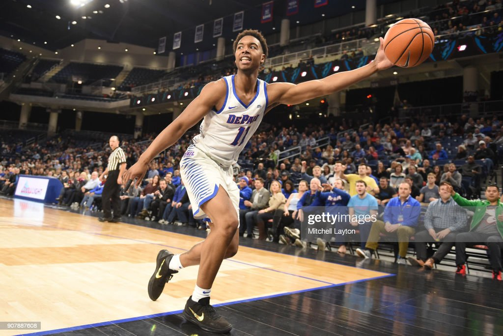 Eli Cain #11 of the DePaul Blue Demons tries to keep the ball in bounds during a college basketball game against the Providence Friars at Wintrust Arena on January 12, 2018 in Chicago, Illinois. The Friars won 71-64.