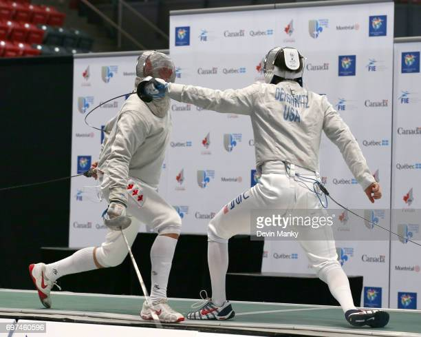 Eli Dershwitz of the USA fences Fares Arfa of Canada during the gold medal match in the Team Men's Sabre event on June 18 2017 at the PanAmerican...