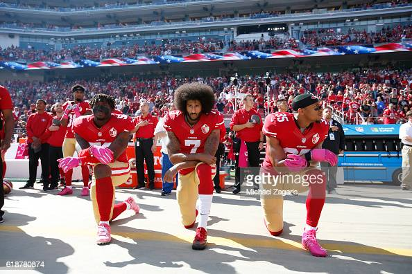 Eli Harold Colin Kaepernick and Eric Reid of the San Francisco 49ers kneel for the anthem prior to the game against the Tampa Bay Buccaneers at Levi...