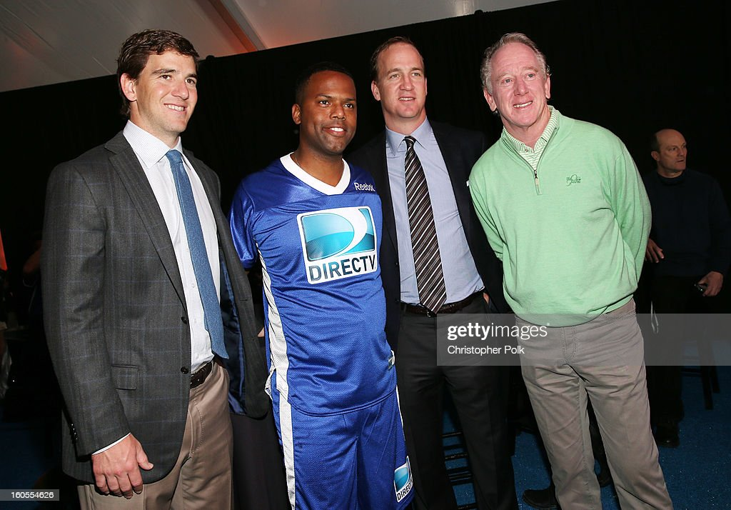 Eli Manning, A. J. Calloway, Peyton Manning, and Archie Manning attend DIRECTV'S Seventh Annual Celebrity Beach Bowl at DTV SuperFan Stadium at Mardi Gras World on February 2, 2013 in New Orleans, Louisiana.