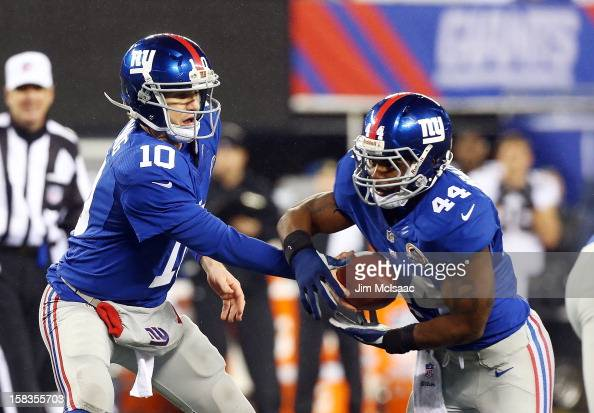Eli Manning and Ahmad Bradshaw of the New York Giants in action against the New Orleans Saints at MetLife Stadium on December 9 2012 in East...