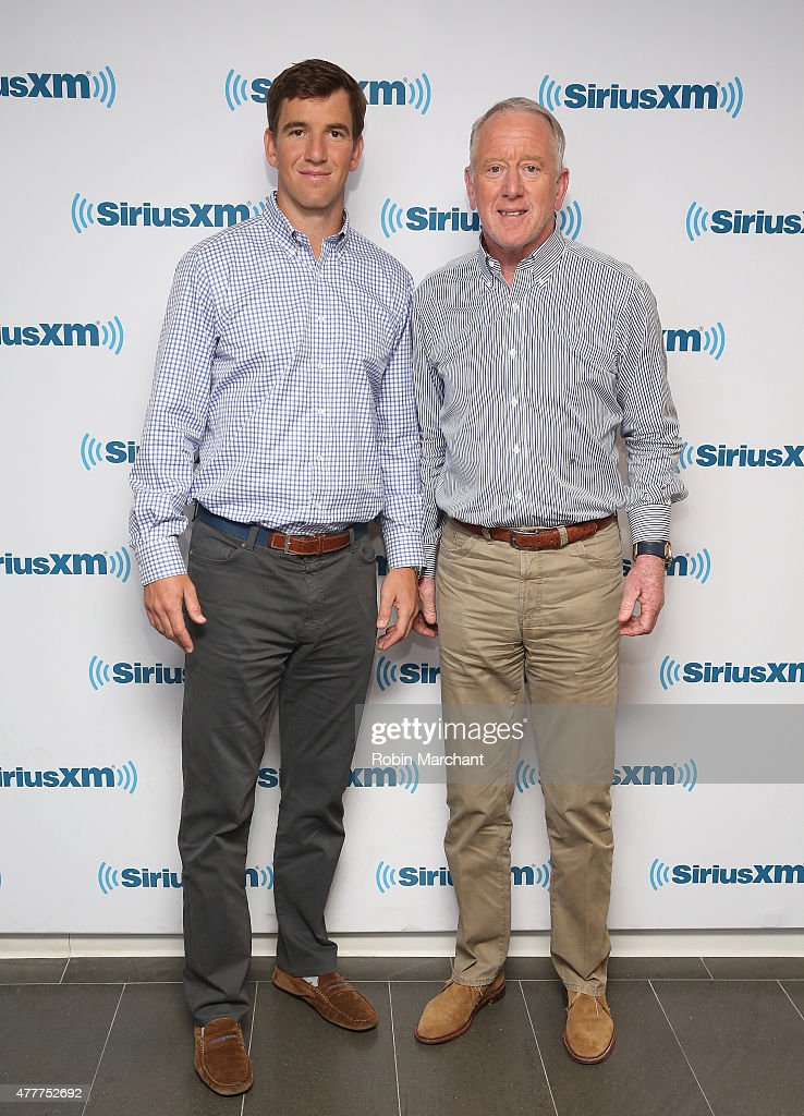 Eli Manning (L) and Archie Manning visit at SiriusXM Studios on June 19, 2015 in New York City.