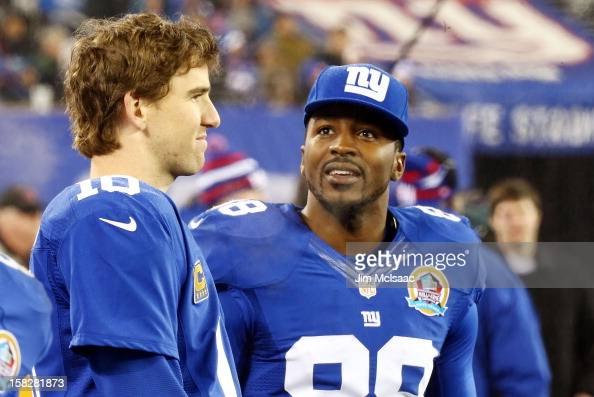 Eli Manning and Hakeem Nicks of the New York Giants look on against the New Orleans Saints at MetLife Stadium on December 9 2012 in East Rutherford...