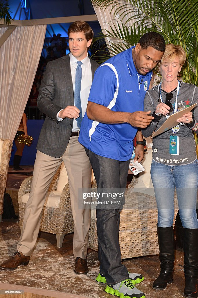 Eli Manning, and Michael Strahan attend DIRECTV'S Seventh Annual Celebrity Beach Bowl at DTV SuperFan Stadium at Mardi Gras World on February 2, 2013 in New Orleans, Louisiana.