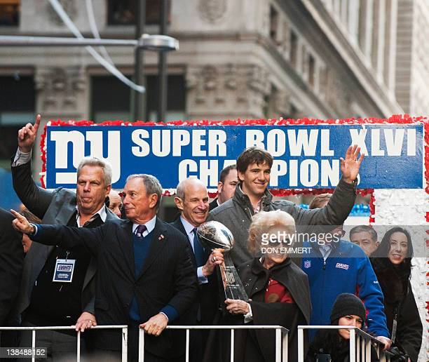 Eli Manning and others aboard the VIP truck as it makes it way up Broadway during the New York Giants ticker tape parade February 7 2012 in New York...