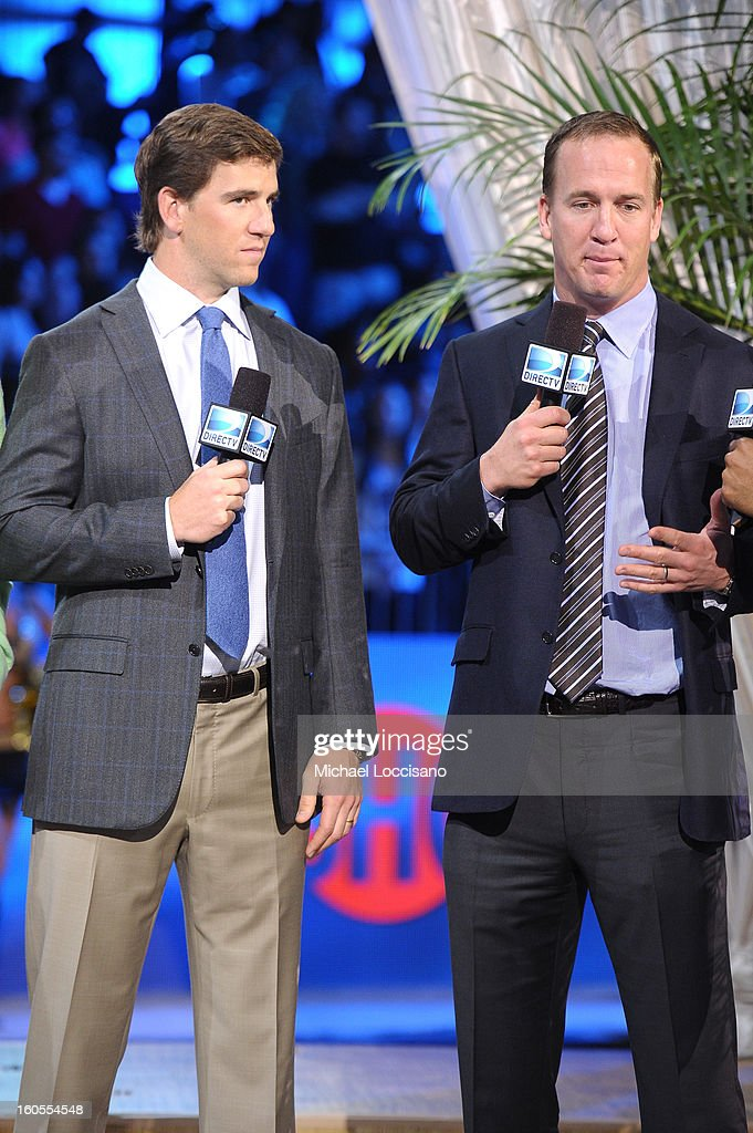 Eli Manning and Peyton Manning attend DIRECTV'S Seventh Annual Celebrity Beach Bowl at DTV SuperFan Stadium at Mardi Gras World on February 2, 2013 in New Orleans, Louisiana.